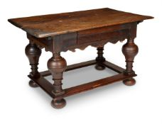 A OAK SIDE TABLE IN 17TH CENTURY FLEMISH STYLE