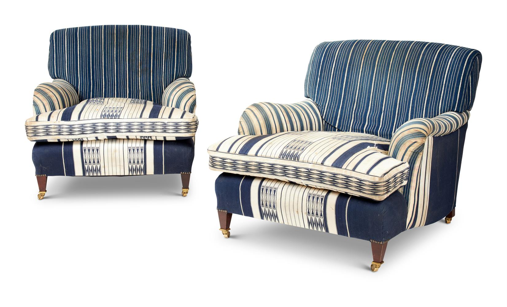 A PAIR OF HOWARD & SONS SYTLE UPHOLSTERED EASY CHAIRS