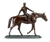 A PATINATED BRONZE MODEL OF A JOCKEY ON HORSEBACK