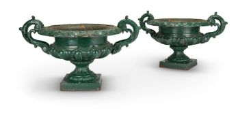 A PAIR OF VICTORIAN GREEN PAINTED CAST IRON URNS, POSSIBLY BY HANDYSIDE