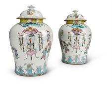 A GOOD PAIR OF CHINESE 'FAMILLE ROSE' VASES AND COVERS