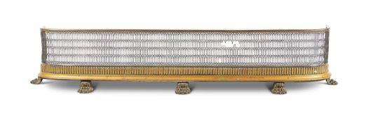 A REGENCY PIERCED BRASS FENDER, EARLY 19TH CENTURY