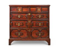 AN OAK CHEST OF DRAWERS, 17TH CENTURY AND LATER