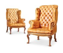 A PAIR OF GEORGE II STYLE WALNUT FRAMED ARMCHAIRS