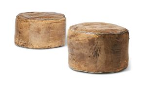 TWO SIMILAR DISTRESSED LIGHT BROWN HIDE POUFFES
