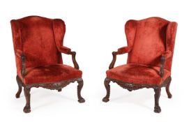 A PAIR OF CARVED WALNUT AND UPHOLSTERED WING ARMCHAIRS, LATE 19TH CENTURY
