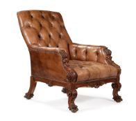 A VICTORIAN CARVED WALNUT AND BUTTONED LEATHER UPHOLSTERED LIBRARY ARMCHAR, SECOND HALF 19TH CENTURY