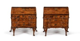 A NEAR PAIR OF SOUTH GERMAN FIGURED WALNUT AND CROSSBANDED BUREAUX, MID 18TH CENTURY