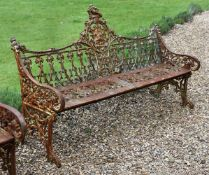 A CAST IRON BENCH IN THE COALBROOKDALE 'GOTHIC' PATTERN, LATE 20TH CENTURY