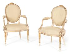 A PAIR OF GEORGE III CREAM PAINTED AND PARCEL GILT OPEN ARMCHAIRS, CIRCA 1775