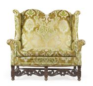A WALNUT AND UPHOLSTERED WING BACK SOFA IN WILLIAM & MARY STYLE, LATE 19TH CENTURY