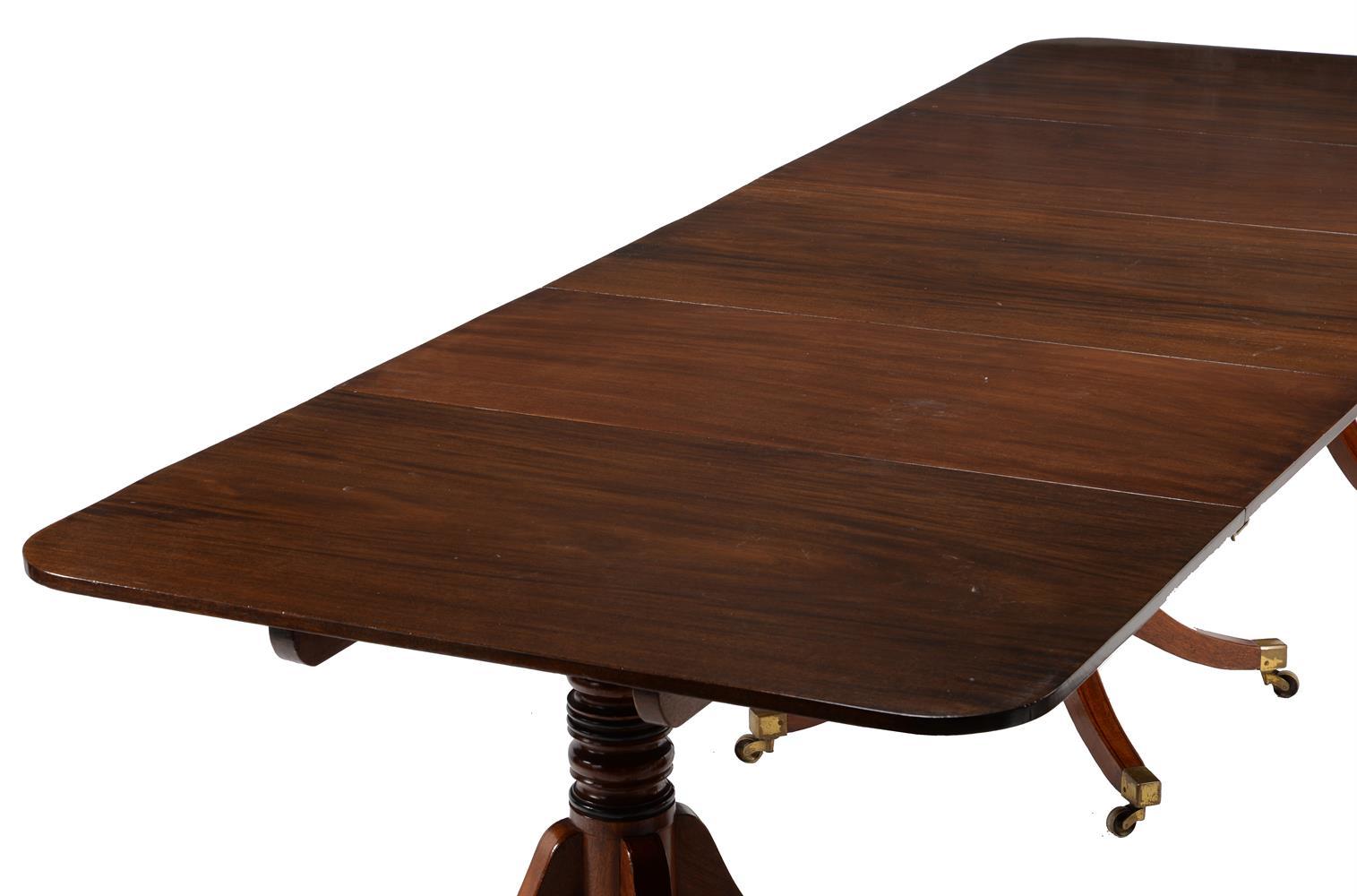 A REGENCY MAHOGANY TRIPLE PILLAR EXTENDING DINING TABLE, CIRCA 1815 - Image 3 of 3