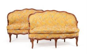 A PAIR OF LOUIS XV WALNUT AND UPHOLSTERED SOFAS, CIRCA 1770