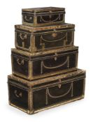 A GRADUATED SET OF FOUR LEATHER AND BRASS BOUND TRUNKS, FIRST HALF 19TH CENTURY