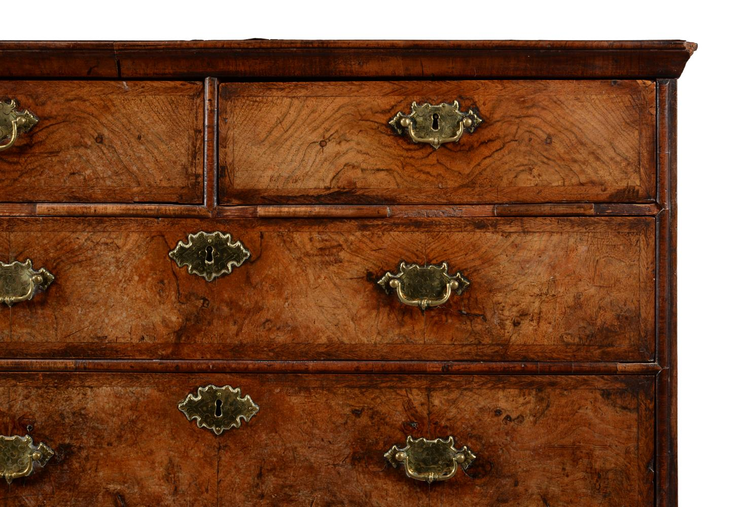 A GEORGE II WALNUT AND FEATHER BANDED CHEST OF DRAWERS, CIRCA 1740 - Image 2 of 3