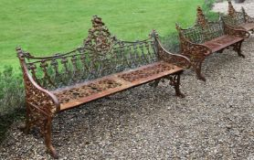 A PAIR OF CAST IRON BENCHES IN THE COALBROOKDALE 'GOTHIC' PATTERN, LATE 20TH CENTURY