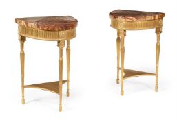 A PAIR OF GEORGE III GILTWOOD DEMI-LUNE PIER TABLES, CIRCA 1785