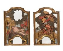 A PAIR OF SPANISH GILTWOOD FRAMED MIRRORS OVERLAID WITH CARVED RELIEFS OF ST LAWRENCE AND ST MICHAEL
