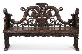 A CONTINENTAL CARVED PINE HALL BENCH, LATE 18TH/EARLY 19TH CENTURY