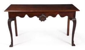 AN IRISH GEORGE II MAHOGANY HALL OR SERVING TABLE, CIRCA 1750