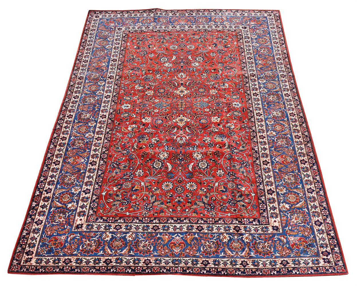 AN ISFAHAN CARPET, approximately 338 x 229cm