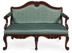 A GEORGE II WALNUT AND UPHOLSTERED SETTEE, CIRCA 1755