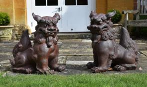 A PAIR OF TERRACOTTA GUARDIAN LIONS OR 'DOGS OF FO', CONTEMPORARY