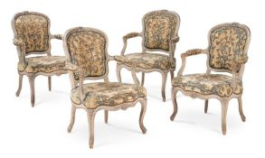 A SET OF FOUR LOUIS XV BEECH, CREAM PAINTED AND NEEDWORK UPHOLSTERED OPEN ARMCHAIRS, CIRCA 1765