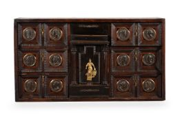 AN ITALIAN WALNUT AND EBONISED 'MEDAL CABINET', LATE 17TH/EARLY 18TH CENTURY