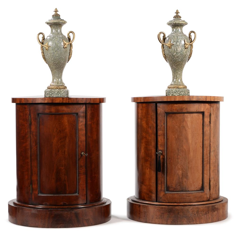 A PAIR OF GEORGE IV MAHOGANY CYLINDRICAL BEDSIDE OR PEDESTAL CUPBOARDS, CIRCA 1825