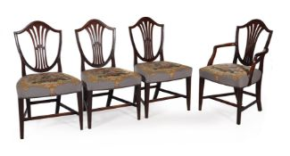 A SET OF EIGHT GEORGE III MAHOGANY DINING CHAIRS, CIRCA 1790