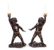 A PAIR OF CONTINENTAL CARVED WALNUT MODELS OF BOYS, 19TH CENTURY, PROBABLY ITALIAN