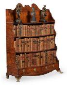 A REGENCY POLLARD OAK AND LINE INLAID 'WATERFALL' OPEN BOOKCASE, CIRCA 1820