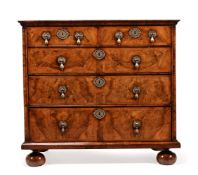 A WILLIAM III WALNUT AND FEATHERBANDED CHEST OF DRAWERS, CIRCA 1700