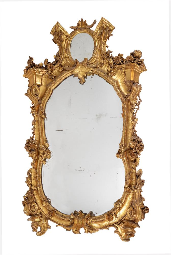 A CONTINENTAL CARVED GILTWOOD WALL MIRROR, 19TH CENTURY