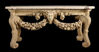 A CREAM PAINTED CARVED WOOD CONSOLE TABLE, IN THE MANNER OF WILLIAM KENT
