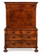 A QUEEN ANNE WALNUT AND FEATHER BANDED ESCRITOIRE, CIRCA 1710