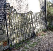 A PAIR OF BLACK PAINTED CAST AND WROUGHT IRON GATES, EARLY 20TH CENTURY