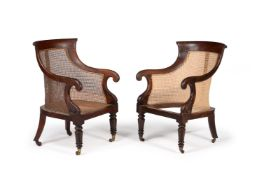 A MATCHED PAIR OF WILLIAM IV MAHOGANY BERGERE LIBRARY ARMCHAIRS, CIRCA 1835