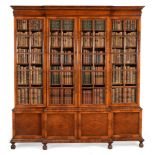 A WALNUT AND SEAWEED MARQUETRY BREAKFRONT BOOKCASE, 20TH CENTURY, BY GILL & REIGATE