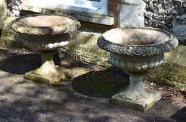 A PAIR OF STONE URNS, IN THE MANNER OF AUSTIN & SEELY, 20TH CENTURY