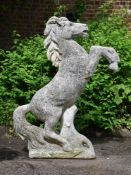 A COMPOSITION STONE MODEL OF A PRANCING HORSE, 20TH CENTURY