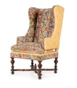 A WALNUT AND NEEDLEWORK UPHOLSTERED WING ARMCHAIR, 17TH CENTURY AND LATER ELEMENTS