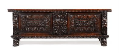 AN ITALIAN CARVED WALNUT CASSONE, LATE 17TH/EARLY 18TH CENTURY
