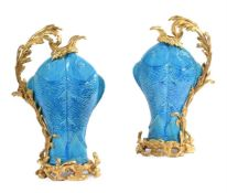 A PAIR OF GILT BRONZE MOUNTED CHINESE TURQUOISE GLAZED PORCELAIN DOUBLE CARP EWERS