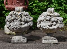 A PAIR OF LIMESTONE FINIALS MODELLED AS FRUITING BASKETS, 20TH CENTURY