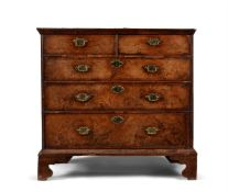 A GEORGE II WALNUT AND FEATHER BANDED CHEST OF DRAWERS, CIRCA 1740
