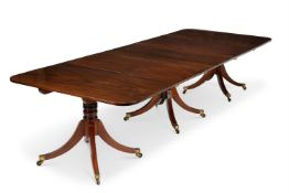 A REGENCY MAHOGANY TRIPLE PILLAR EXTENDING DINING TABLE, CIRCA 1815