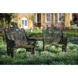 A PAIR OF BLACK PAINTED CAST IRON GARDEN SEATS, SECOND HALF 19TH CENTURY