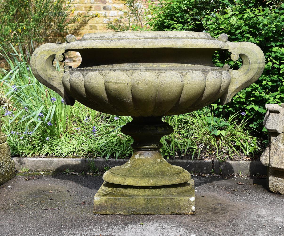 A MONUMENTAL CARVED STONE TWIN HANDLED PEDESTAL VASE, MID-19TH CENTURY